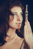 Elegant woman with flute instrument. Royalty Free Stock Photography