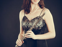 Elegant woman with flute instrument. Royalty Free Stock Photos