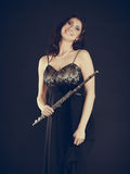 Elegant woman with flute instrument. Royalty Free Stock Photo