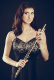 Elegant woman with flute instrument. Stock Photo