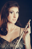 Elegant woman with flute instrument. Stock Photography