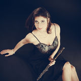 Elegant woman with flute instrument. Stock Photos