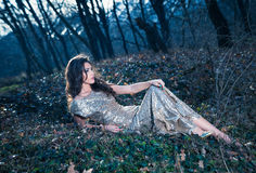 Elegant woman in forest Stock Photography