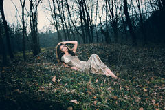 Elegant woman in forest Stock Photos