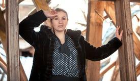 Elegant woman in fur coat against ruined building Royalty Free Stock Images
