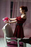 Elegant woman with gift box. Christmas tome. New Year eve Stock Photography