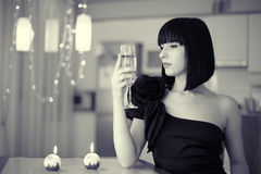 Elegant woman with glass of drink, celebrating Royalty Free Stock Images