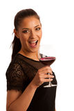 Elegant woman with a glass of red wine Stock Image