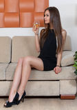 Elegant woman with a glass of wine Royalty Free Stock Photo