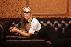 Elegant woman with glasses  on sofa Stock Images