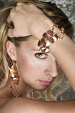 Elegant woman and gold jewelry Stock Photography