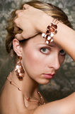 Elegant woman and gold jewelry Stock Image