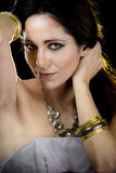Elegant woman with golden light, gold and silver Royalty Free Stock Images