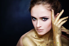 Elegant Woman with Golden Skin and Glamorous Party Makeup Royalty Free Stock Images