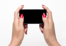 Elegant woman hands holding a smartphone Royalty Free Stock Photo