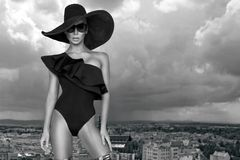 Elegant woman in a hat, bikini and sunglasses and amazing high heels shoes. In Louvre Paris France Royalty Free Stock Images