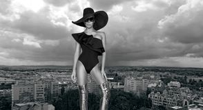 Elegant woman in a hat, bikini and sunglasses and amazing high heels shoes. In Louvre Paris France Royalty Free Stock Photos