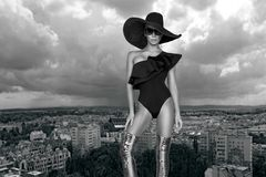 Elegant woman in a hat, bikini and sunglasses and amazing high heels shoes. In Louvre Paris France Royalty Free Stock Photo
