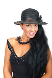 Elegant woman with hat in black royalty free stock image