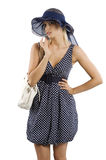 Elegant woman with hat and hand bag Royalty Free Stock Images