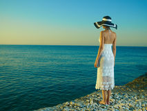 Elegant woman in a hat at sea Royalty Free Stock Images