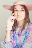 Elegant woman with hats. Pink tone portrait. Elegant woman with hats Royalty Free Stock Photos