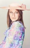 Elegant woman with hats. Pink tone portrait. Elegant woman with hats Stock Photos