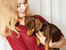 Elegant woman with her mixed dog Royalty Free Stock Photos