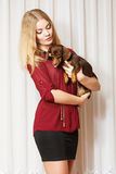 Elegant woman with her mixed dog Stock Photo
