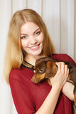 Elegant woman with her mixed dog Stock Image