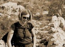 Hiker portrait on the rocky mountain. Elegant woman hiker walking on dangerous rocky terrain.nMt.Mosor. Croatia Stock Photography