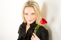 Elegant woman hold red rose Royalty Free Stock Photography