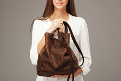 Elegant woman holding fashion bag Royalty Free Stock Images