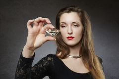 Elegant woman holding giant diamond Royalty Free Stock Photography