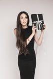 Elegant woman holding gift Royalty Free Stock Photos