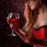 Elegant woman holding glass of wine Stock Photography