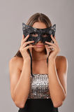 Elegant woman holding a masquerade mask Stock Photo