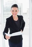Elegant woman holding out a document in office Royalty Free Stock Photo