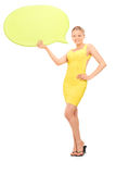 Elegant woman holding a speech bubble Royalty Free Stock Images