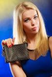 Elegant woman holds black handbag Royalty Free Stock Photo