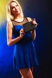 Elegant woman holds black handbag Stock Image