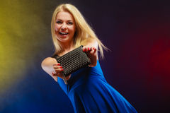 Elegant woman holds black handbag Royalty Free Stock Photos