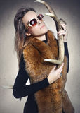 Elegant woman with a horn deer Stock Image
