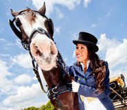 Elegant woman with a horse Royalty Free Stock Images