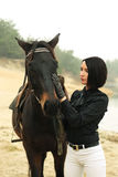 Elegant woman with a horse near the river Royalty Free Stock Photos