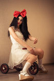 Elegant woman in the image of doll on bicycle Stock Photography