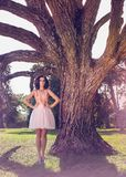 Elegant Woman In A Party Pink Dress Standing In A Power Position Royalty Free Stock Photos
