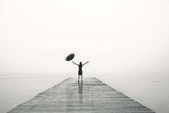 Free Elegant Woman In Black Rejoices With Their Arms Up In The Rain Royalty Free Stock Photos - 68614818