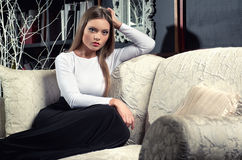Elegant woman indoors stock images