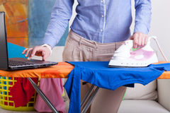 Elegant woman during ironing Stock Photo